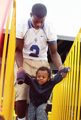 Diapers, then football practice: Life as a teen father